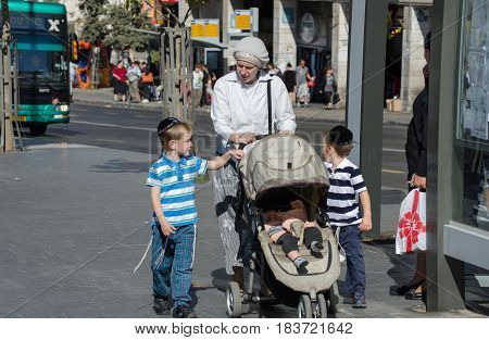 Orthodox Jewish Woman With Childs Walk In Jerusalem. Israel