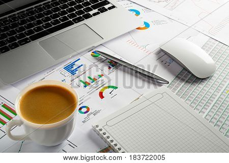 Business documents on desk. Notepad coffee laptop and pen on table, start of Morning work office. Business concept background