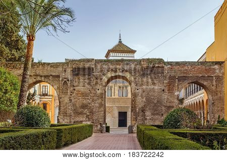 Courtyard at the entrance to Alcazar of Seville with wall from XI century Spain