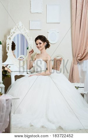 Beautiful young bride portrait with wedding makeup hairstyle dress.