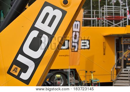 VILNIUS LITHUANIA - APRIL 27: JCB heavy duty equipment vehicle and logo on April 27 2017 in Vilnius Lithuania. JCB corporation is manufacturing equipment for construction and agriculture.