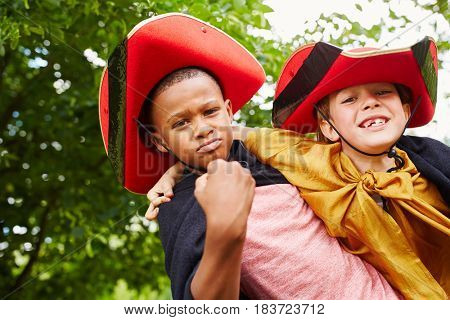 Interracial friends in carnival with costumes