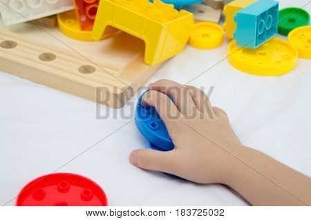 Children are playing a variety of colors happily.