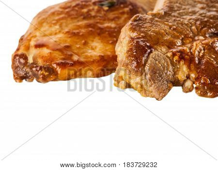 two pieces of baked meat on white background