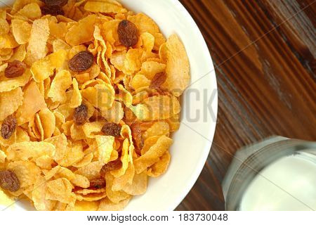 Healthy breakfast with a bowl of cornflakes and a glass of milk. Top view flat lay