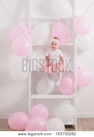 the funny beautiful little girl with balloons