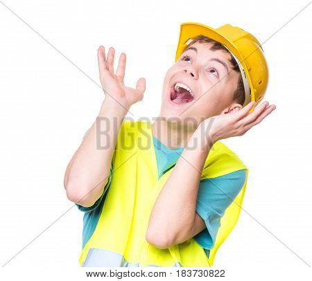 Emotional portrait of handsome caucasian teen boy wearing safety jacket and yellow hard hat. Surprised child looking up, isolated on white background.