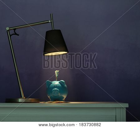 Table with piggy bank and money on illuminated surface under lamp