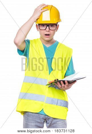 Emotional portrait of handsome caucasian teen boy wearing safety jacket and yellow hard hat. Shocked child with notebook, isolated on white background.