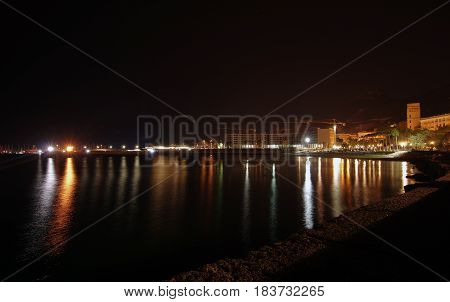 harbor and coastline at night in Salerno Italy