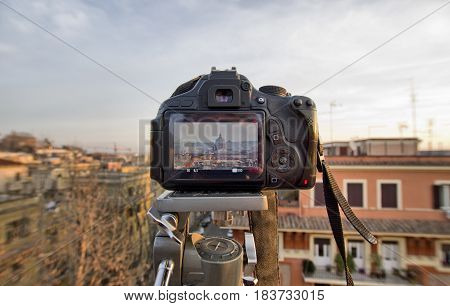 DSLR Camera On Tripod Shooting roofs of Rome