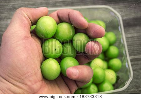 A handful of sour plums,  Salt and plum food is very tasty. There are a handful of sour plums, sour plums for pregnant women, ant women,