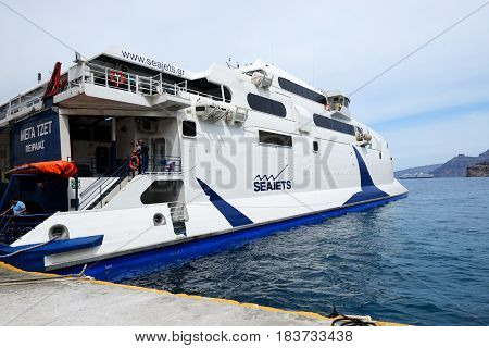 SANTORINI GREECE - MAY 17: The speed ferry going to Crete island on May 17 2014 in Santorini Greece. The ferry transports thousands passengers daily.