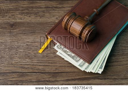 Wooden table with hammer, money