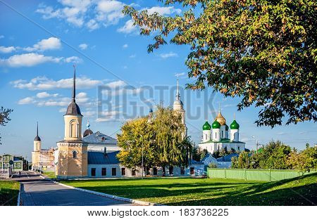 Kolomna view of the Cathedral and the wall of the convent with a lawn on a Sunny summer day with clouds in the sky