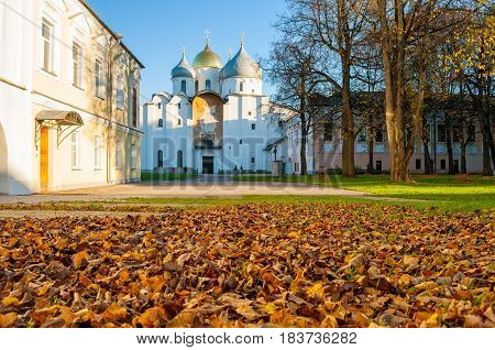 St Sophia Russian Orthodox cathedral at sunny autumn evening in Veliky Novgorod Russia - architecture autumn landscape of architecture landmark with fallen autumn leaves on the foreground