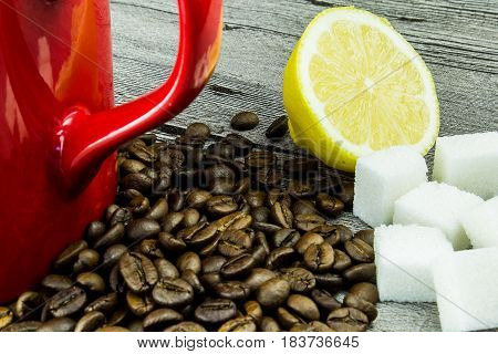 coffee grains with cuplemon and sugar on grunge wooden background