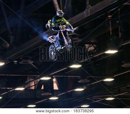 St. Petersburg Russia - 15 April, Biker performing a trick under the ceiling,15 April, 2017. International Motor Show IMIS-2017 in Expoforurum. Moto show at the St. Petersburg moto salon.