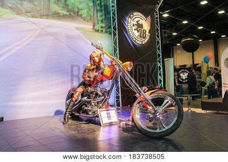 St. Petersburg Russia - 15 April, A fashion model on an exclusive motorcycle,15 April, 2017. International Motor Show IMIS-2017 in Expoforurum. Models on motorcycles presented at the motor show.