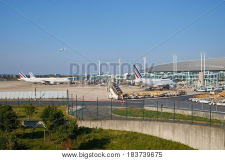 PARIS, FRANCE - CIRCA SEPTEMBER, 2014: Air France passenger aircrafts on the tarmac in Charles de Gaulle Airport. The airport is the largest international airport in France.