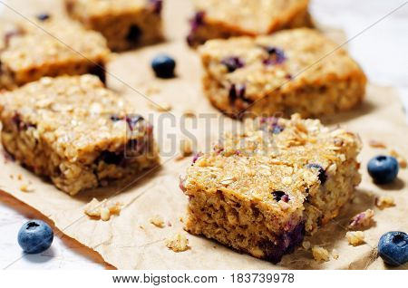 Blueberry Quinoa Oats Breakfast Bars on stone background
