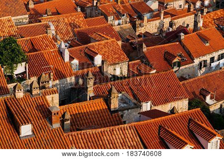 Top view of the roofs with red tiles of European houses in Dubrovnik, Croatia.
