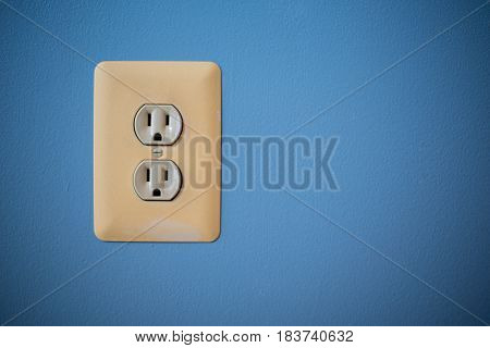 electric wall port with blue background in house