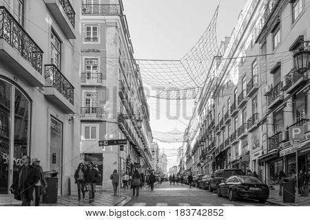 Lisbon, Portugal.- January 11, 2017: Old Town Lisbon on January 11, 2017. street view of typical houses in Lisbon, Portugal, Europe