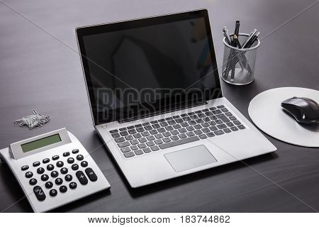Close-up Of A Open Laptop On Office Desk