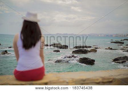 Lonely Woman on a Beautiful Sea Coast