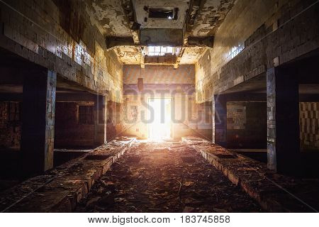 Corridor in abandoned factory building in Voronezh, Russia. Perspective, light in the end concept.