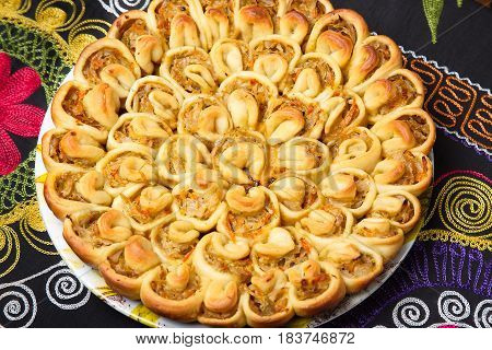 Pie with cabbage of unusual shape. It looks like a chrysanthemum flower.