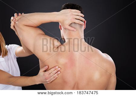 Close-up Of A Physiotherapist Giving Shoulder Massage