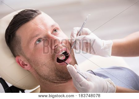 Close-up Of A Young Man Having His Dental Checkup In A Clinic
