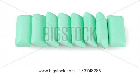 Row of Green Chewing Gums on White Background