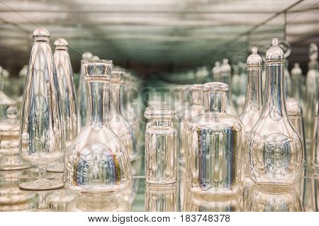 Glass bottles are reflected in the mirror. recursive view