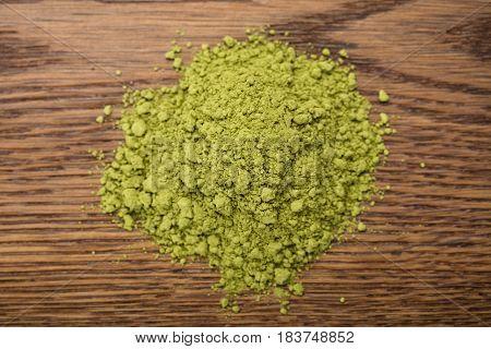 Photo Of Matcha Tea Powder On Wooden Table