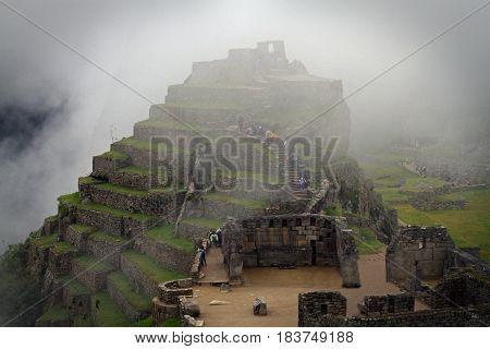 Lost peruvian city Machu Picchu in clouds