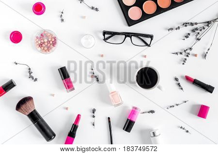 glasses, cup of coffee and decorative cosmetics set on white woman table background top view