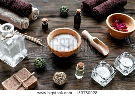 Aromatherapy SPA set with salt and natural oil on wooden background