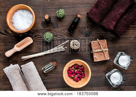 spa set with towels and organic soap on wooden table background top view