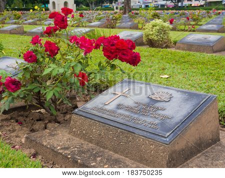 KANCHANABURI THAILAND - AUGUST 2015: Kanchanaburi War Cemetery in Thailand Graveyard for soldiers and captives in the Kwai river bridge