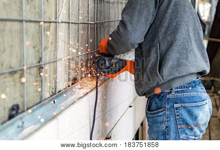 The Process Of Cutting Metal Angles Using Angle Grinder