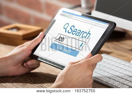 Person Searching Online Job On Digital Tablet