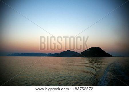 Beautiful sunset at the Aegean sea.Ship trails.
