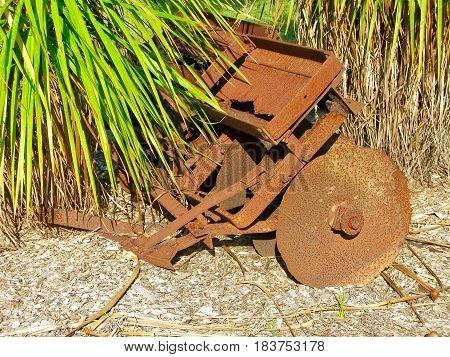 Old disc plow, beyond repair, rusting away