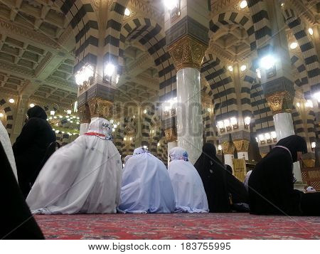MADINAH, SAUDI ARABIA - AUGUST 22: Moslem women from around the world perform prayer and Quran recitation at Prophet Mosque on August 22, 2015 in Madinah, Saudi Arabia.