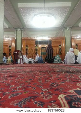 MADINAH, SAUDI ARABIA - AUGUST 21: Moslem women perform prayer at Quba Mosque on August 21, 2015 in Madinah, Saudi Arabia.