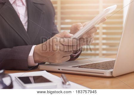 Business woman using tablet computer on desk at work