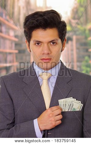Politician with tie putting money in his pocket.